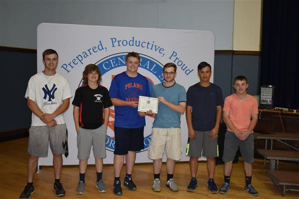 Baseball players holding their PPP award