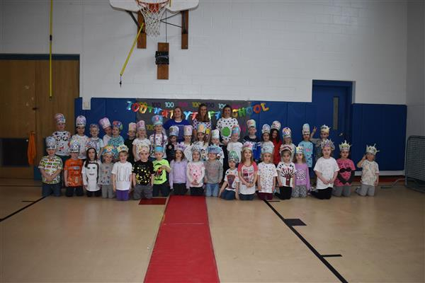 Poland kindergarteners and their teachers pose for a photo while celebrating 100 days of school