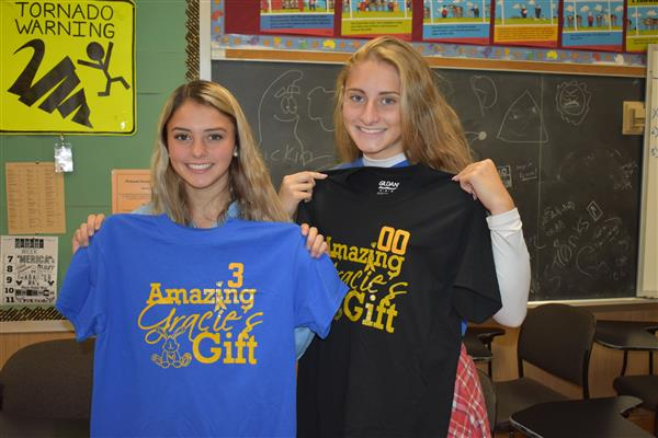Two Poland senior students holding up Amazing Gracie's Gift Foundation shirts