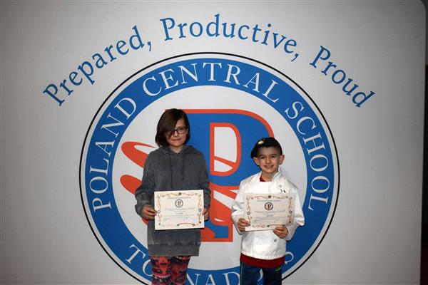 Emma Taylor and Elijah Jones holding PPP Awards in front of Poland logo