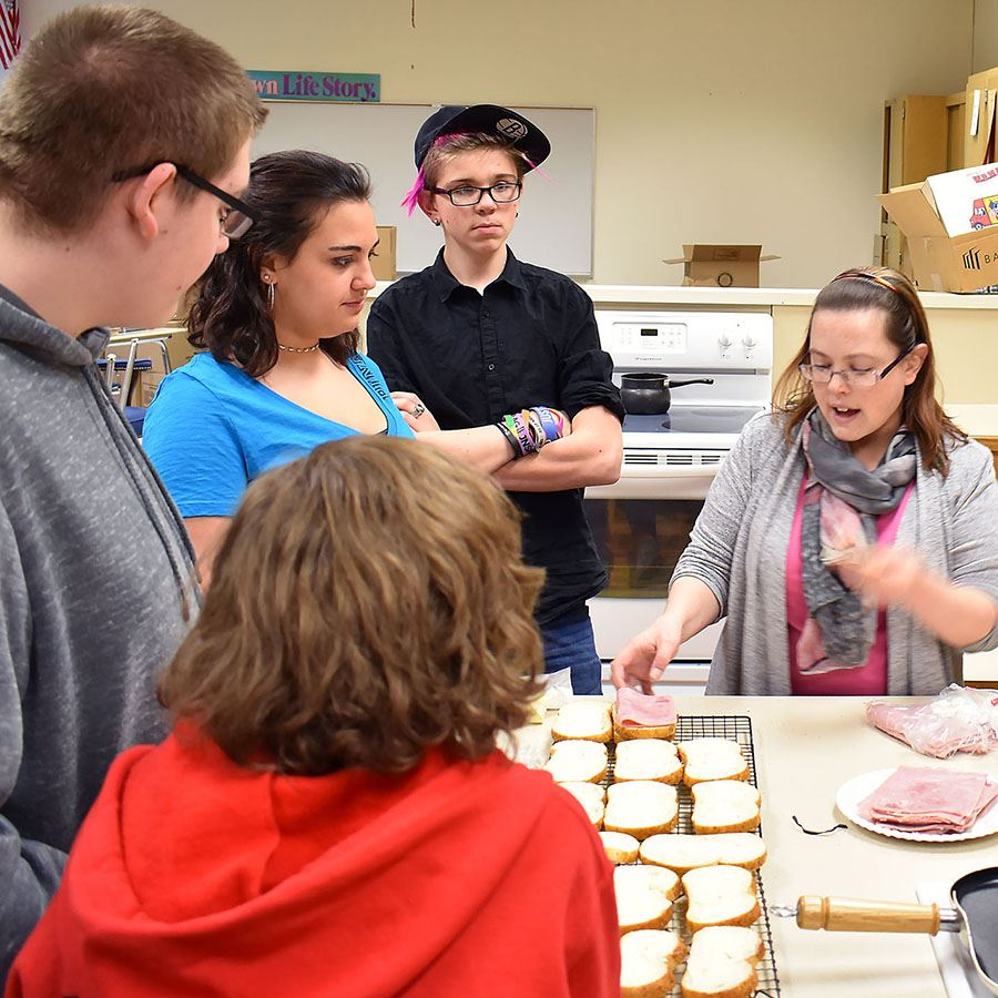 French Club students and teacher Tierra Glover make croque-monsieur sandwiches.