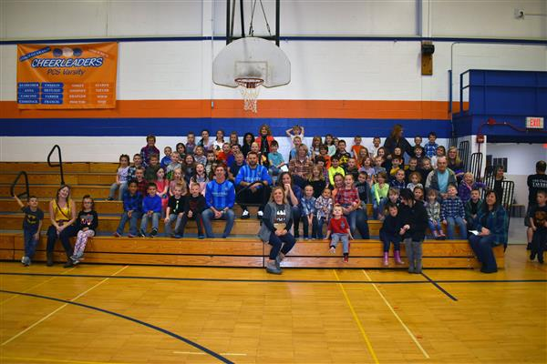 Utica City FC soccer players pose with a group of Poland students
