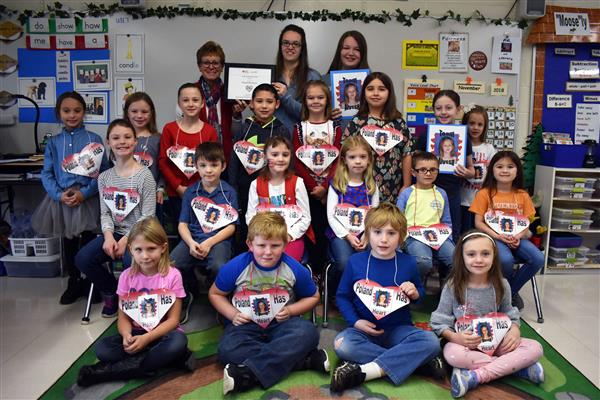 Poland first-graders, teacher Karen Livingston and members of Alyssa's family pose for a phot