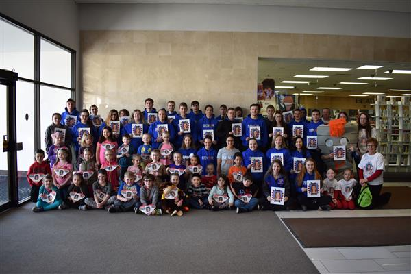 Poland seniors and first-graders as of Feburary 2018 pose at Indoor Heart Walk