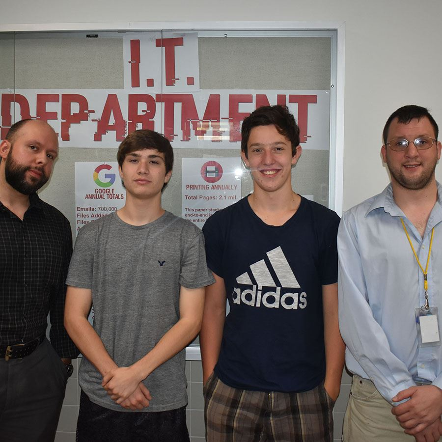 Poland students Tyler Nicotera and Keenan Satterlee posing with Phil Gogol and Jon Sundberg