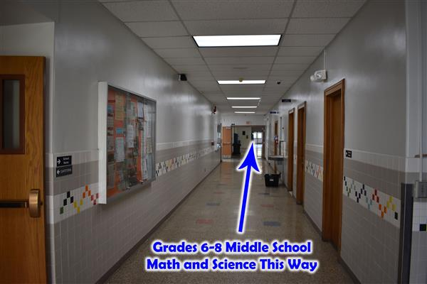 Hallway to middle school math and science with arrow