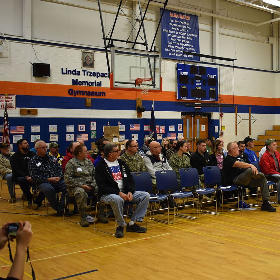 Local veterans sitting in the gym at Poland during the Veterans Day Assembly