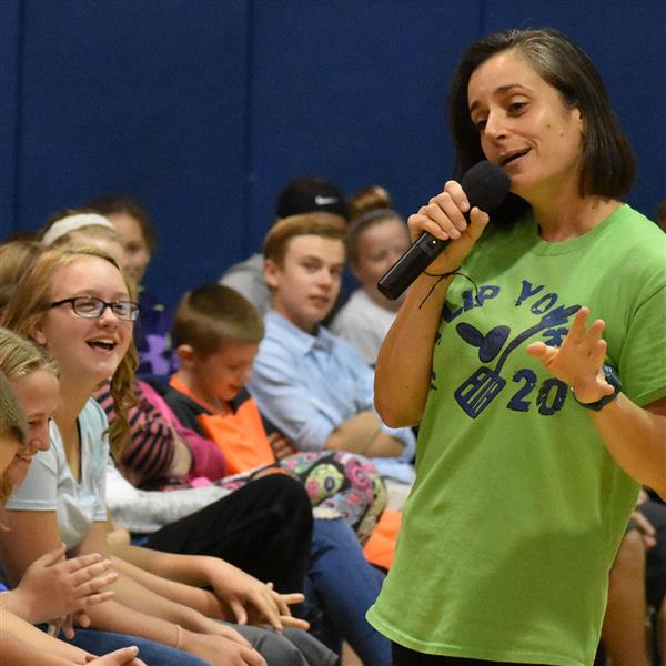Speaker Molly Kennedy talks to Poland students during an assembly