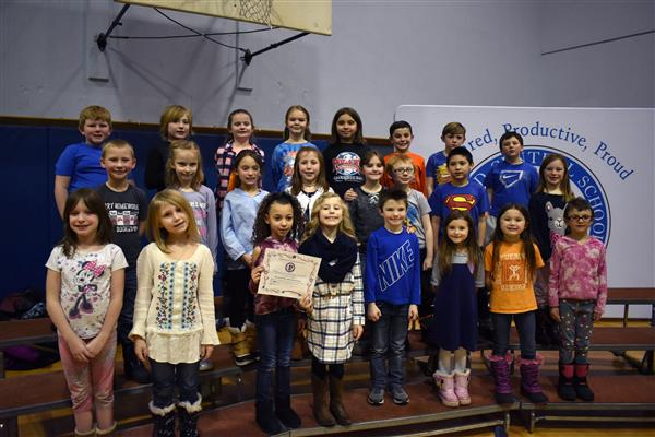 Poland second-graders posing with their PPP Award
