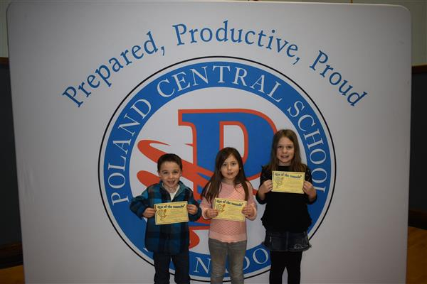 Three students holding Eye of the Tornado Awards
