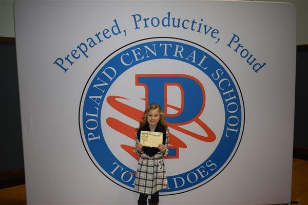 A student holding her Eye of the Tornado Award