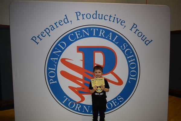 Student holding his Eye of the Tornado Award