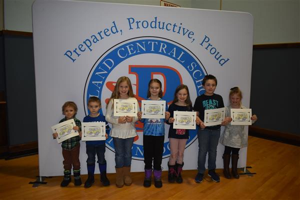 Seven students holding their Safe Rider Awards