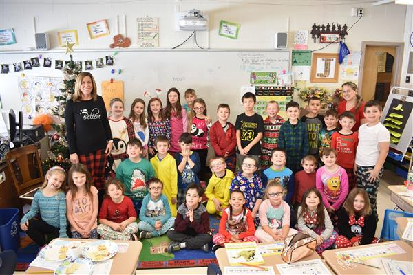 Poland and Herkimer second-graders from two classrooms pose together with their pen pals