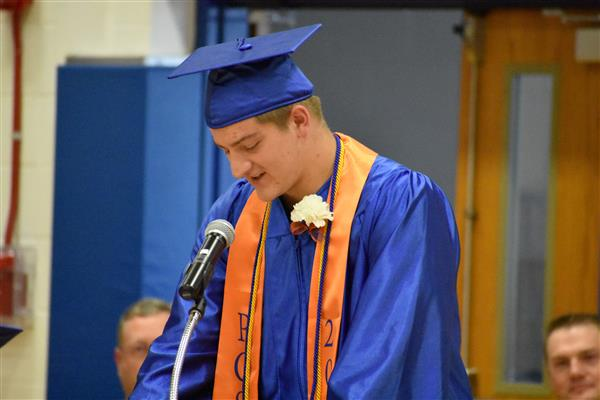 Franklin Szarek speaking at graduation