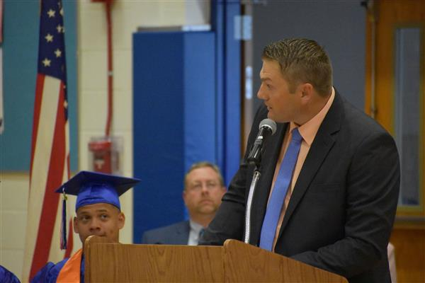 Principal Greg Cuthbertson speaking at Poland graduation