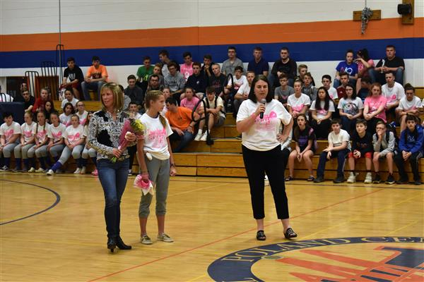 Roxanne Przelski, Shelbi Hagues and Janice Watrous standing on the gym court during an assembly