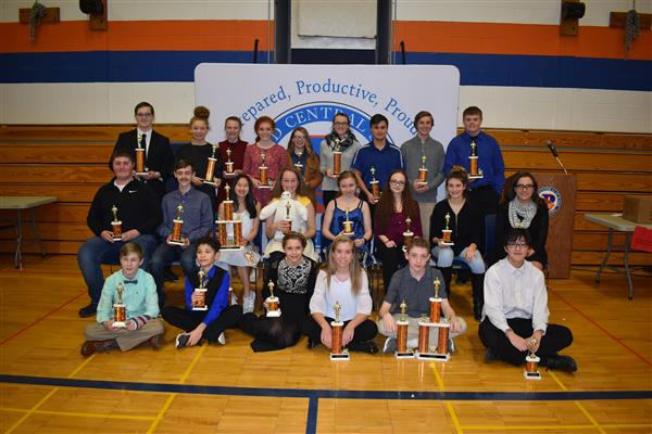 A group of science fair trophy winners holding their awards