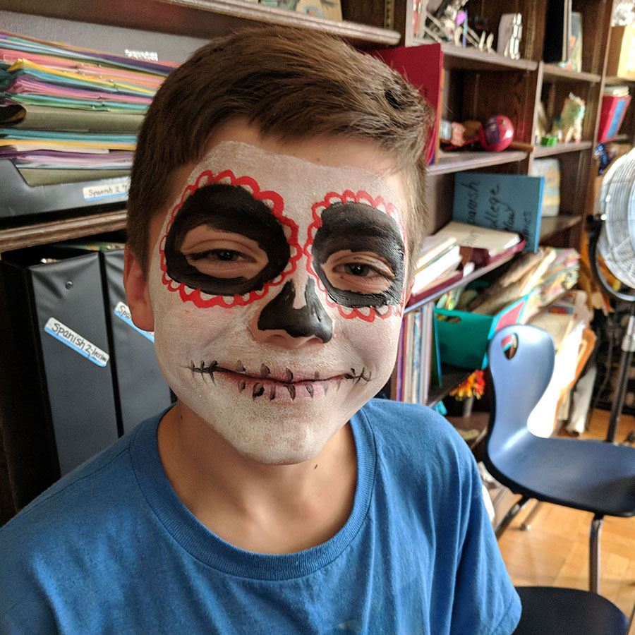 Poland student with face painted for a Day of the Dead festival