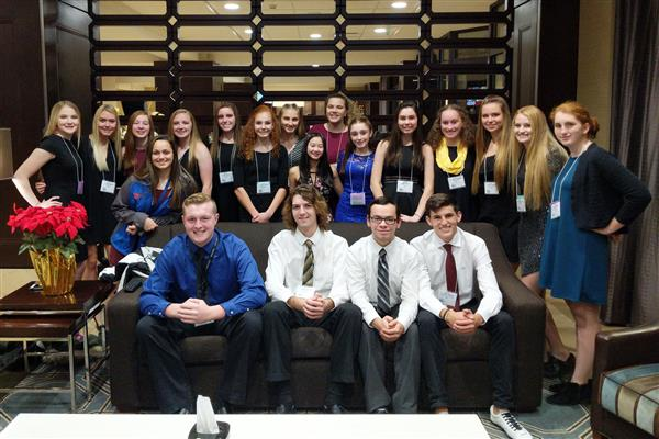Poland student council members posing on and around a couch at state conference