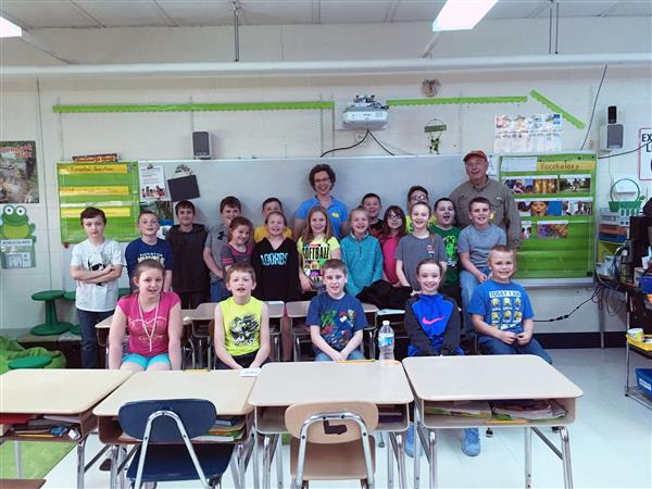 Fourth-graders posing with Lisa Abel and Gary Bartell
