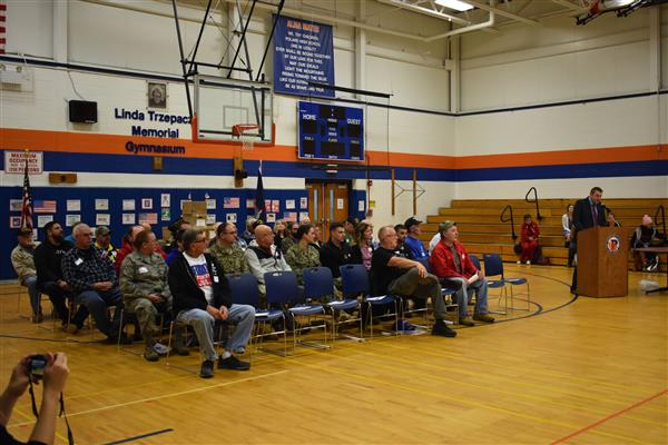 Local veterans sitting in the gym at the Poland Veterans Day Assembly