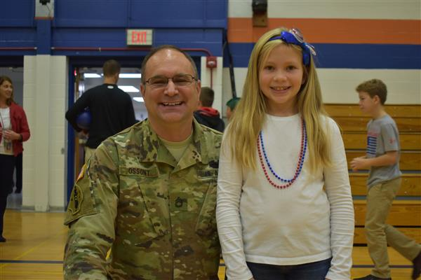 Local veteran poses with his niece after Veterans Day Assembly