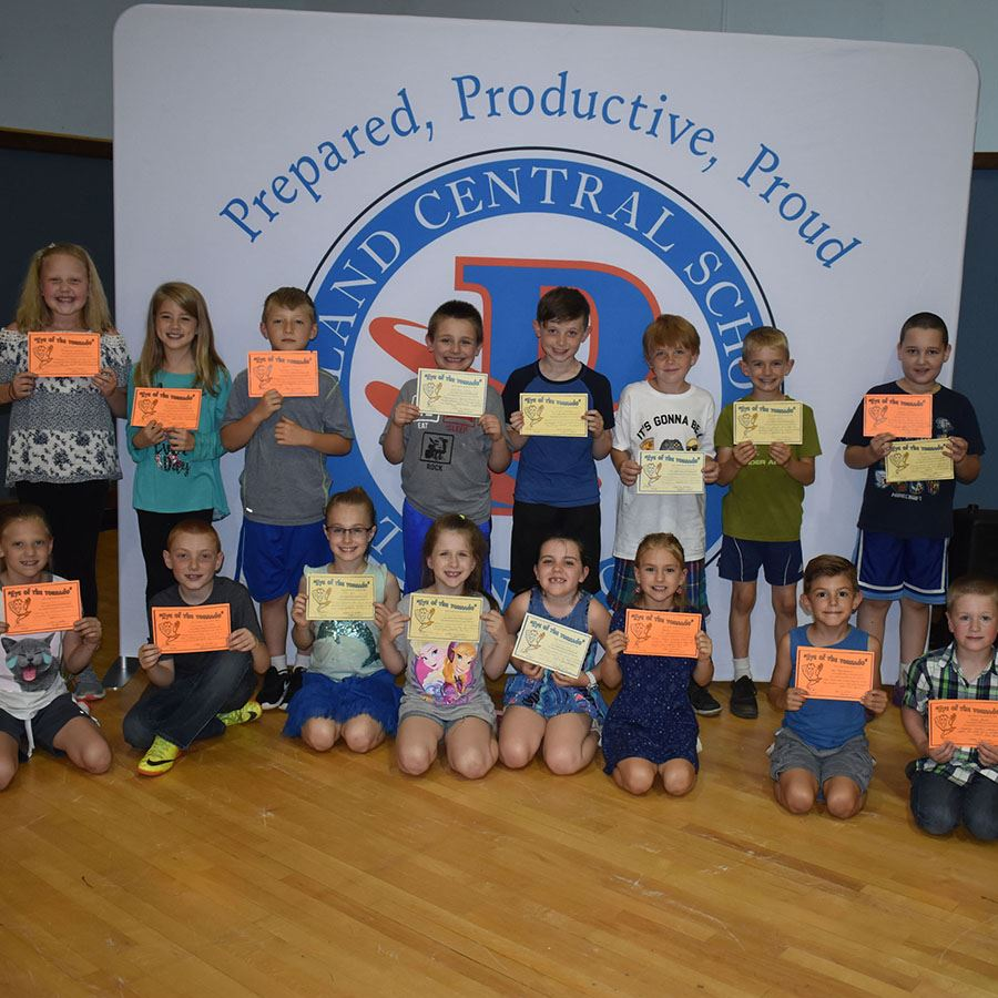 Students holding their Eye of the Tornado awards
