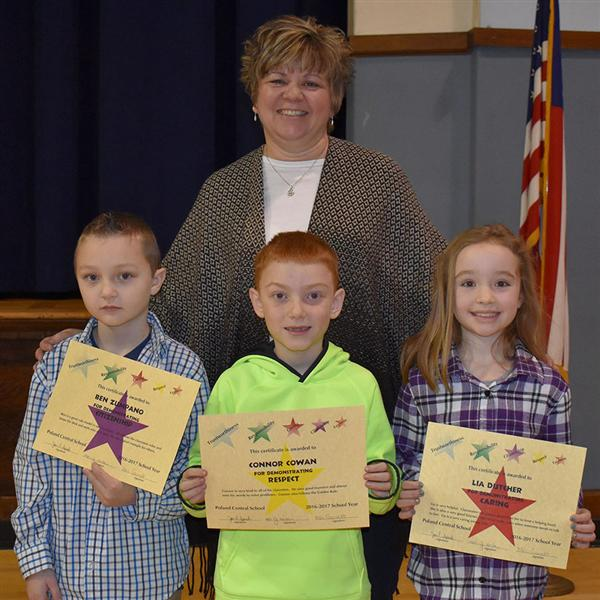 Second grade teacher and students with character awards