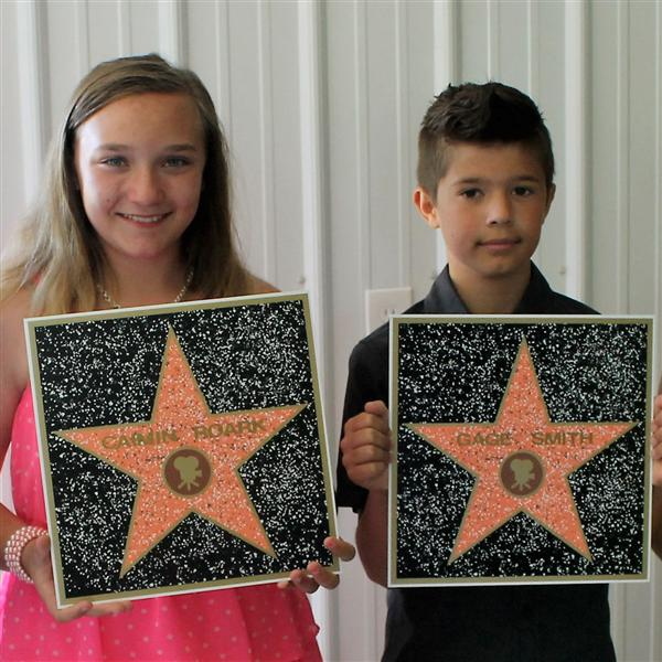 Students holding character education awards